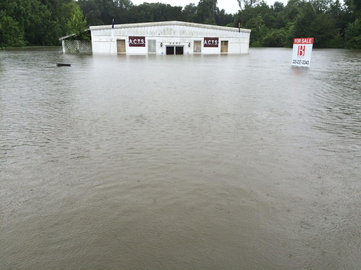 In Central, hundreds await rescue in floods; on Hooper Road flood waters climbing several feet deep