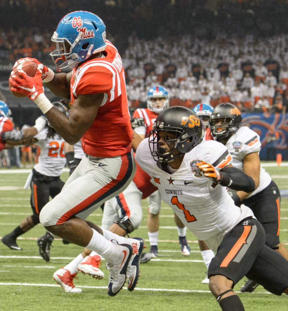 Ole Miss leaves no doubt, dominates Oklahoma State 48-20 in Sugar Bowl _lowres