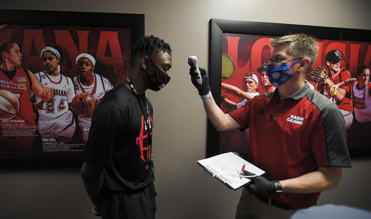 UL football players return for voluntary workouts