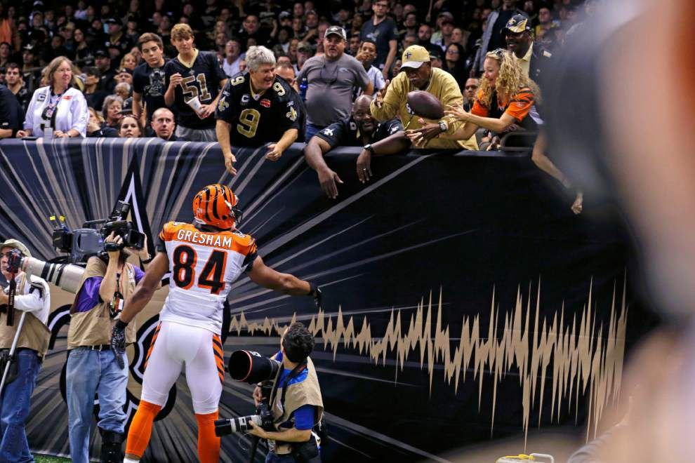 New Orleans Saints fan Tony Williams and Cincinnati Bengals fan Christa Barrett make up over coffee and beignets _lowres