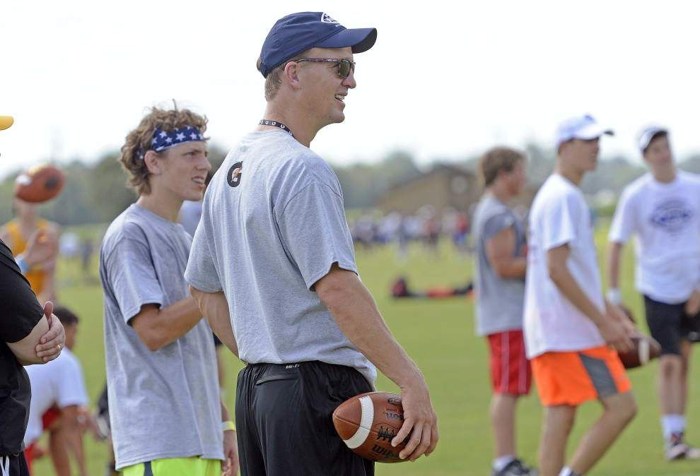 Lewis: Football, not the future, is still what has Peyton Manning's full attention _lowres