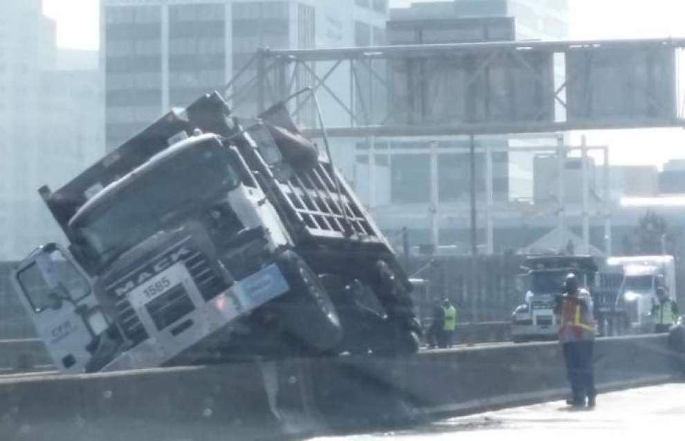 Overturned dump truck shuts down portion of I-10, causes miles-long traffic jam _lowres