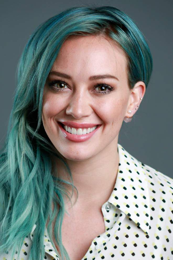 Hilary Duff admits to playing catch up in fast-paced music biz _lowres