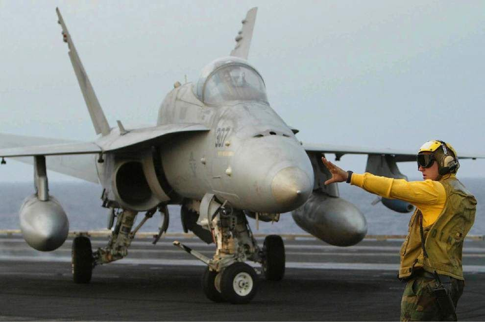 Navy searches for pilot after jets crash into sea _lowres