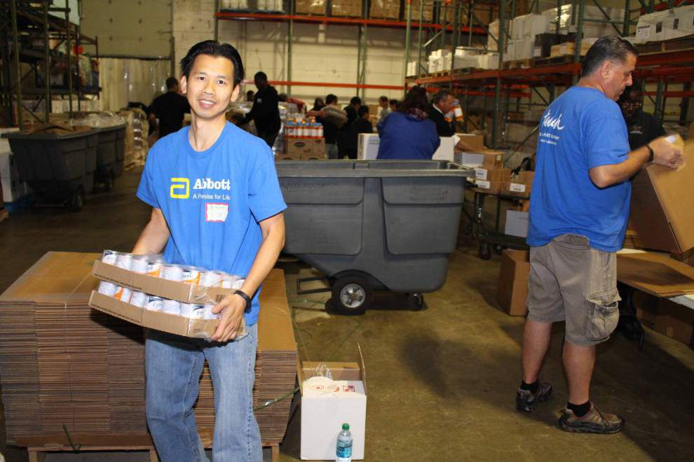 Second Harvest and Abbot partner for third year to prepare disaster relief packets _lowres
