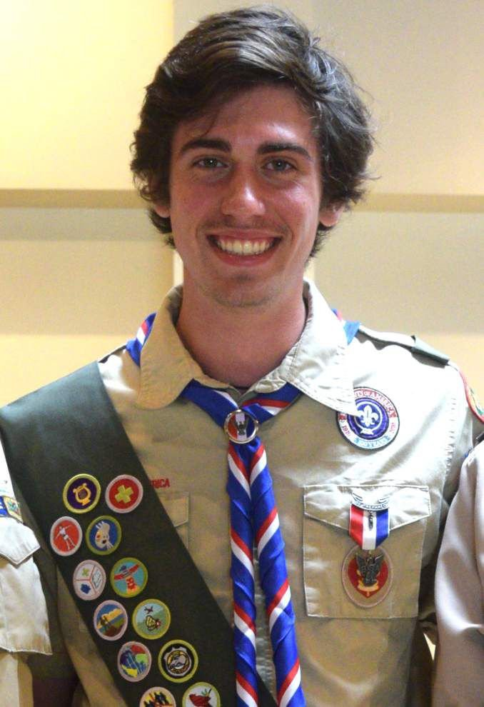 Eagle Scout earns honor with plant signs _lowres