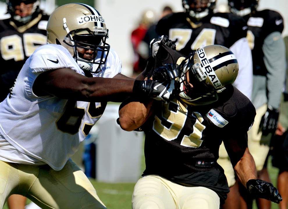 New Orleans Saints' Kasim Edebali keeps his head while he keeps shifting positions _lowres
