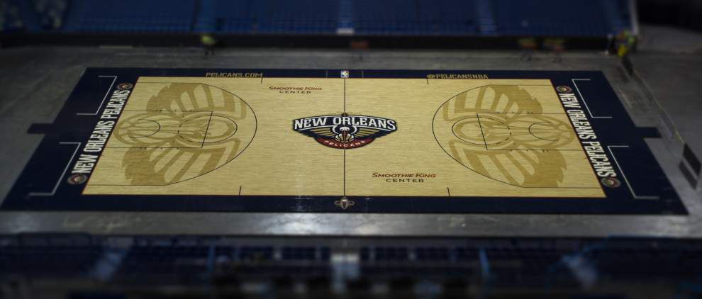 New Orleans Pelicans display their new court for home games in the Smoothie King Center _lowres