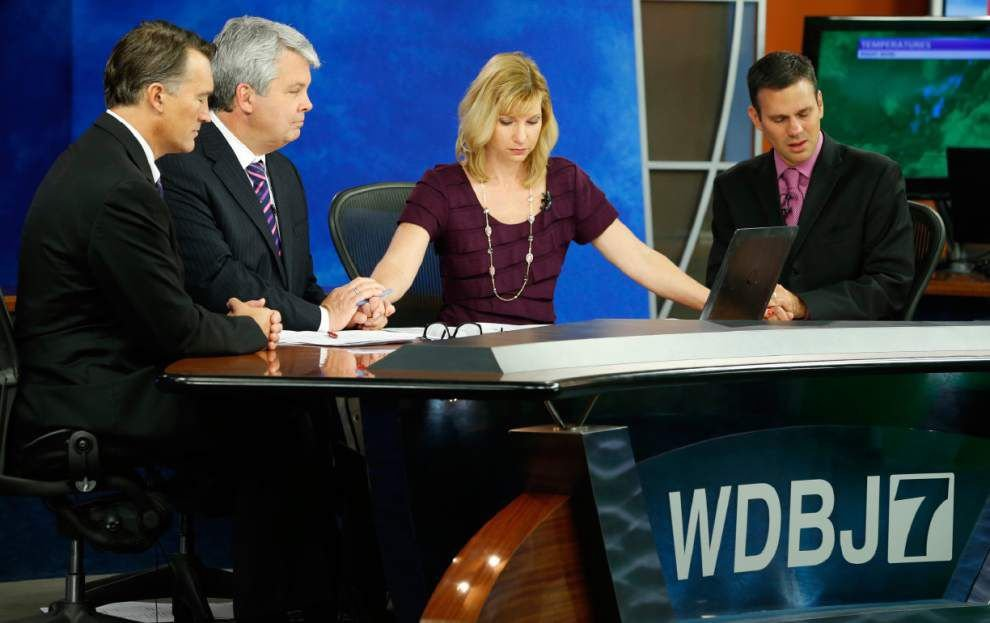 WDBJ observes moment of silence for two journalists killed on air; gunman's family issues statement _lowres