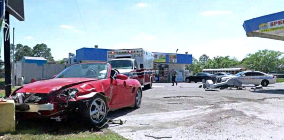 WATCH: Baton rouge police, EMS on scene after Porsche crashes into gas pump _lowres