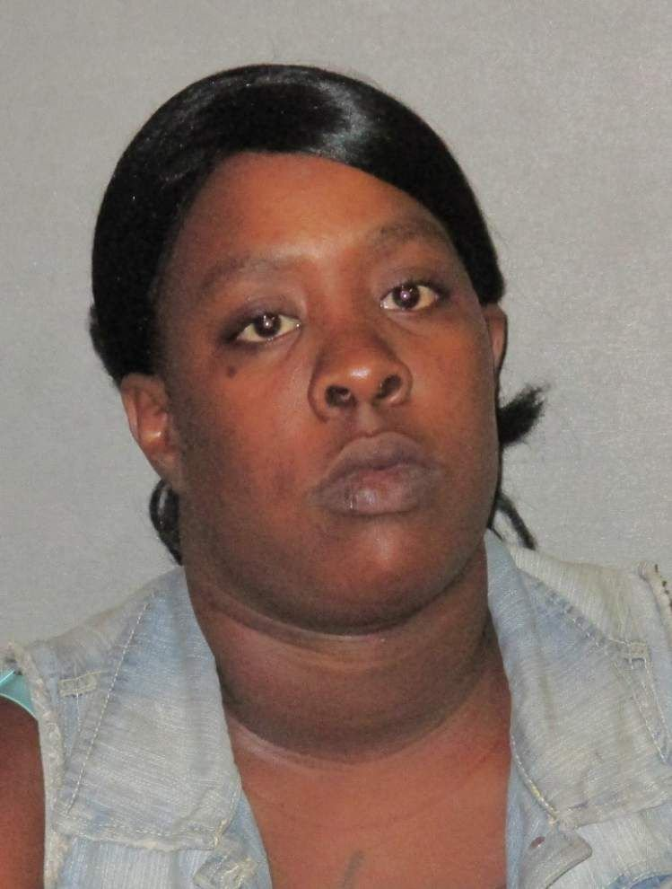 Second woman arrested in September armed robbery of six sleepy men on Kleinpeter Road _lowres