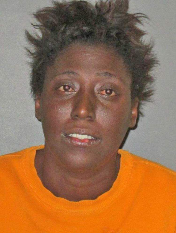 Baton Rouge woman threatened to 'whip' neighbor, set house 'in flames' after complaint filed about dog, police say _lowres