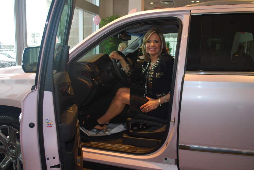 Mary Kay director earns pink Cadillac Escalade _lowres