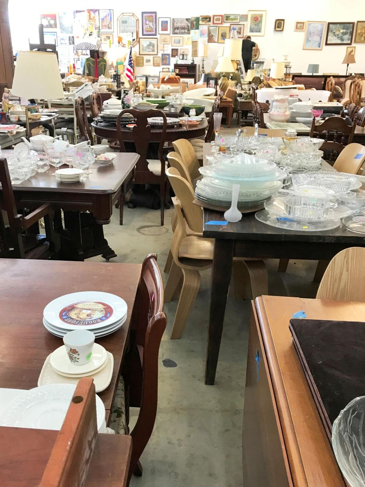 Tables and chairs of every vintage are offered for sale.JPG