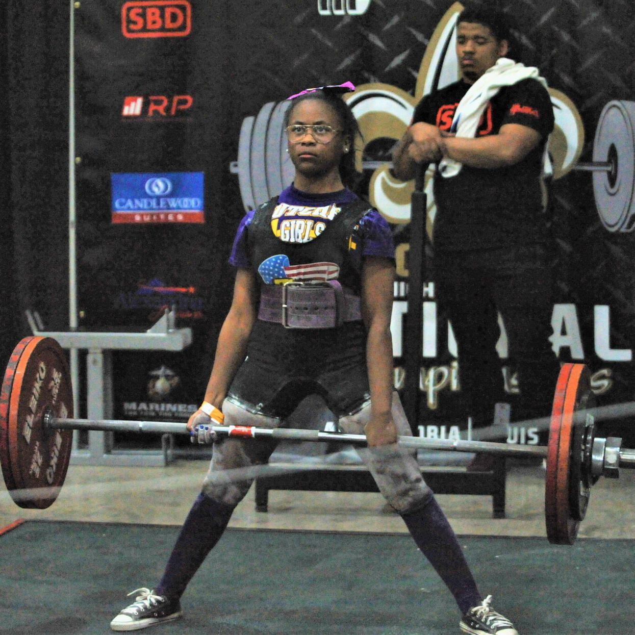 Lutcher's Quamecca Stafford defies size by setting world