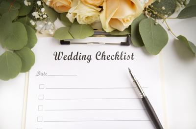 Wedding planning checklist with blank space and roses