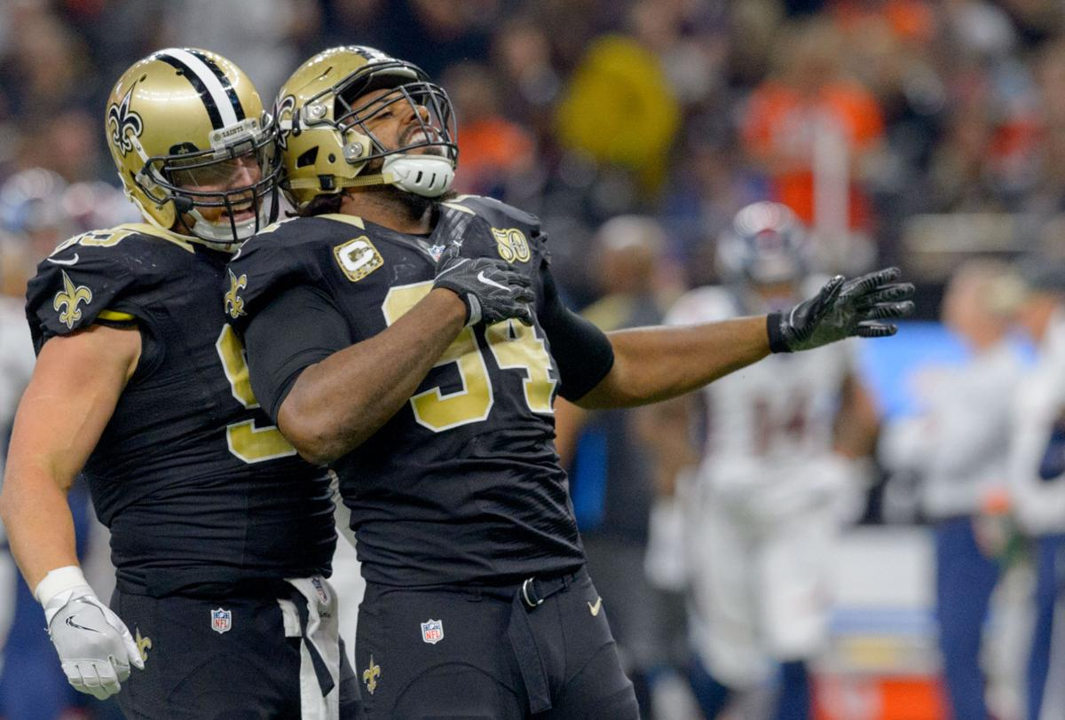 Saints defensive end Cameron Jordan helping carry on Santa with