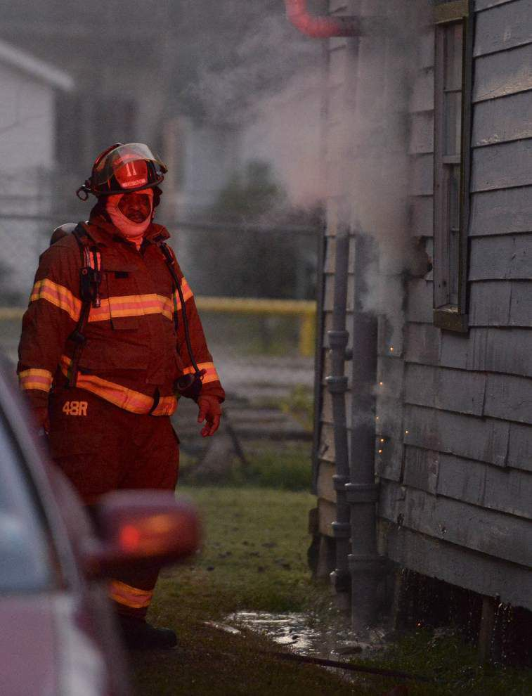 Baton Rouge woman sets house on fire after spraying expansion foam near her home's hot water heater _lowres