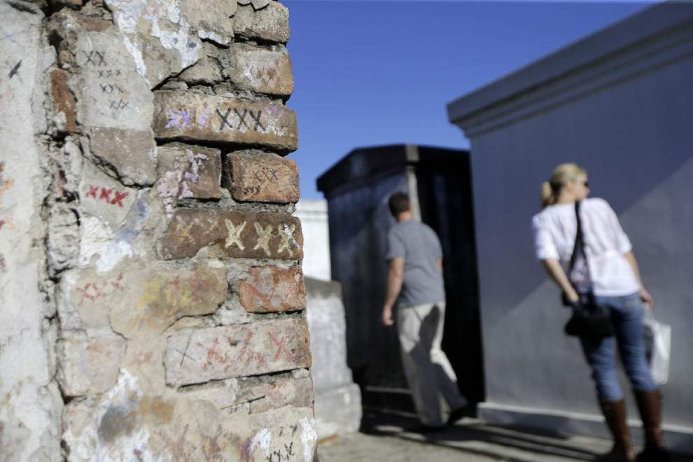 How many have joined Marie Laveau in eternal slumber? Biographer says the famous Voudou queen made room in her landmark tomb for many. _lowres