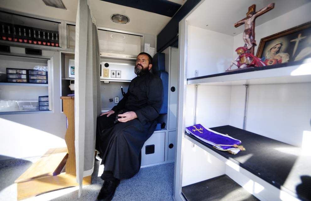 St. Martinville priest's decommmissioned ambulance turned mobile confessional offers a different kind of healing _lowres