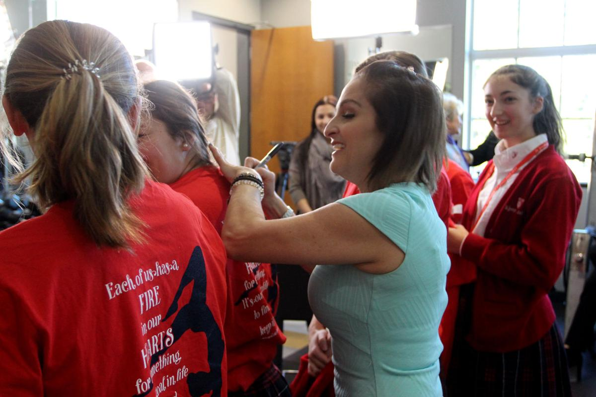 Mary_Lou_Retton_Signing_Autographs_on_Gymnastics_T-Shirt.BR