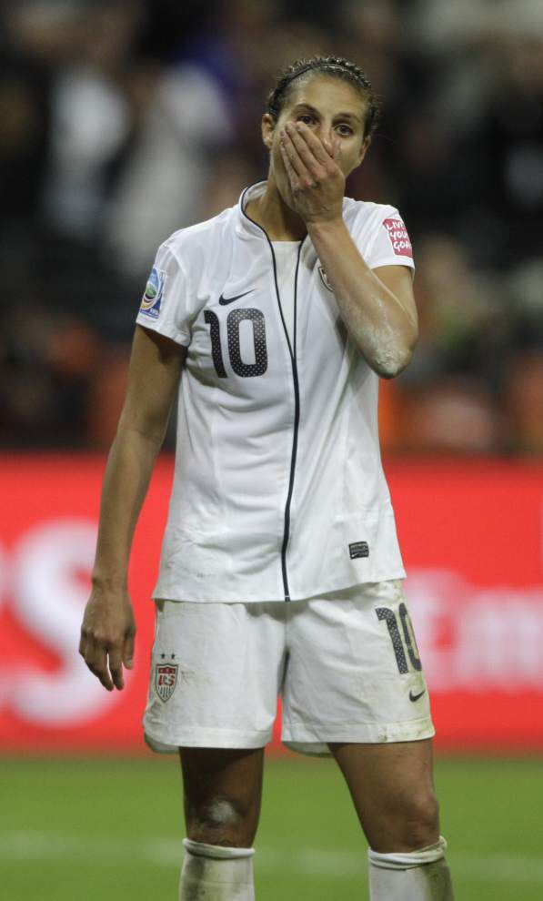 Lingering pain of 2011 loss to Japan keeps U.S. team focused heading into Sunday's Women's World Cup title game _lowres