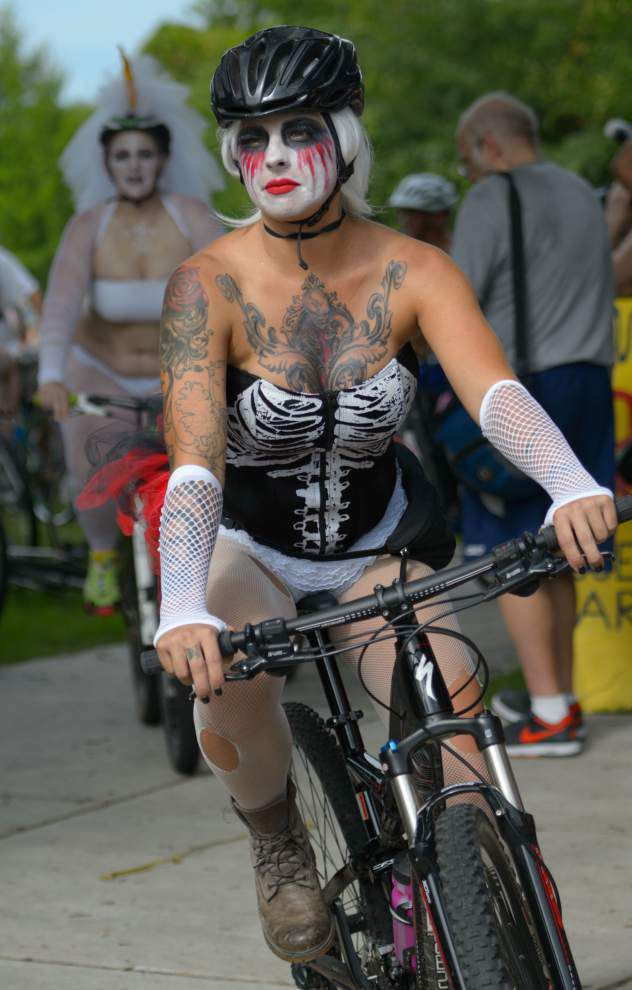 Video: 'Bare as you dare'; Bike riders take it off for New Orleans' World Naked Bike Ride, traffic safety _lowres