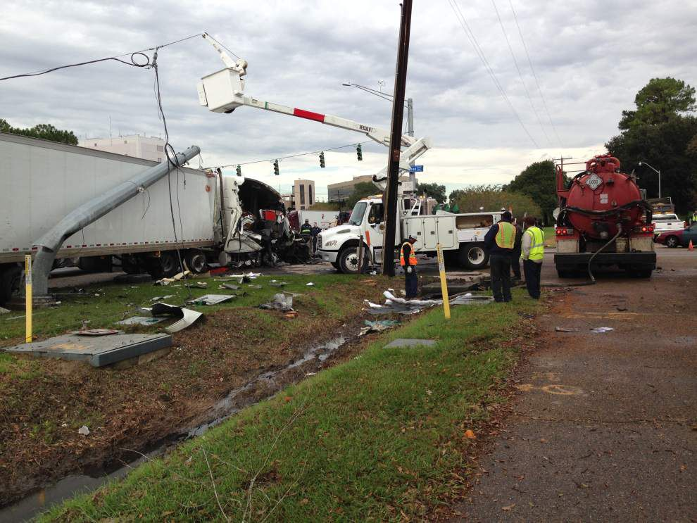 Big rig sustains extensive damage, spills diesel in Airline Highway accident early Wednesday; injuries minor _lowres