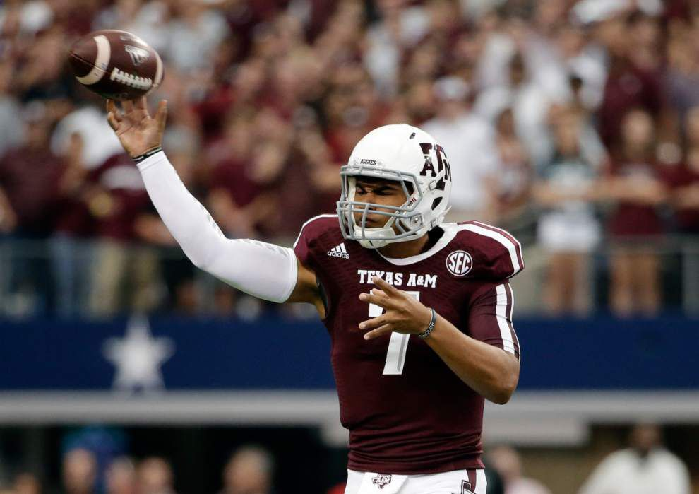 Texas A&M rallies past Arkansas in overtime 35-28 _lowres