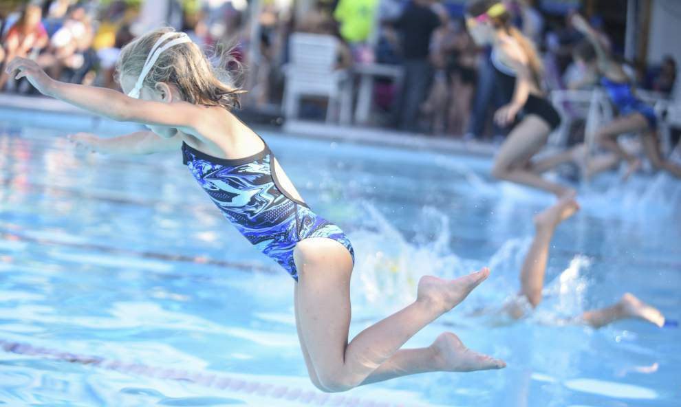 Southern Oaks Athletic Club's Sharks kick off swim team season _lowres