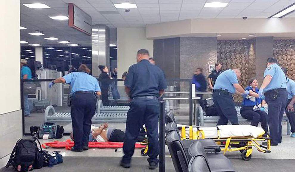 New Orleans airport witness: He was running with 'machete over his head, swinging it through security' _lowres