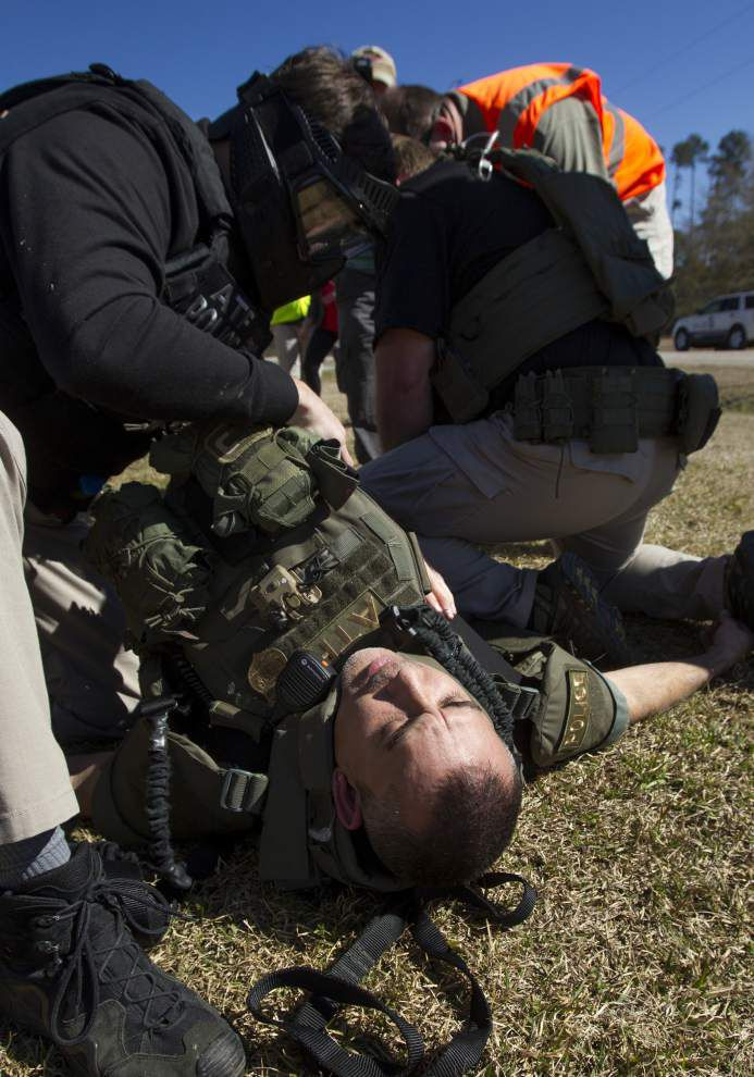Training exercise teaches ATF agents how to save colleagues while under fire _lowres