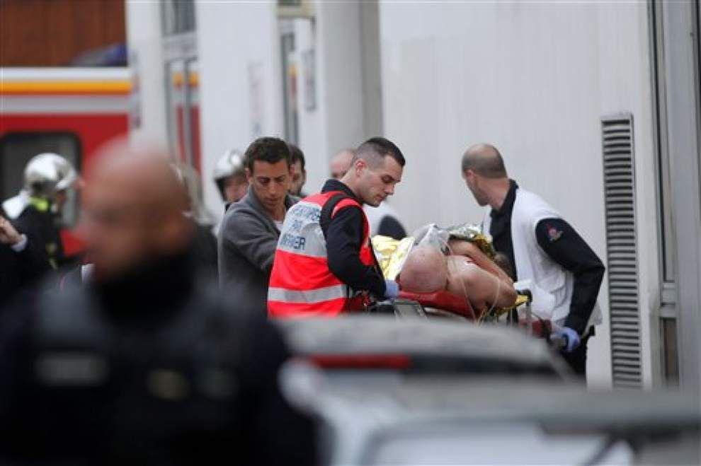 Authorites hunt 2 in Paris shooting that killed 12; 1 surrenders _lowres