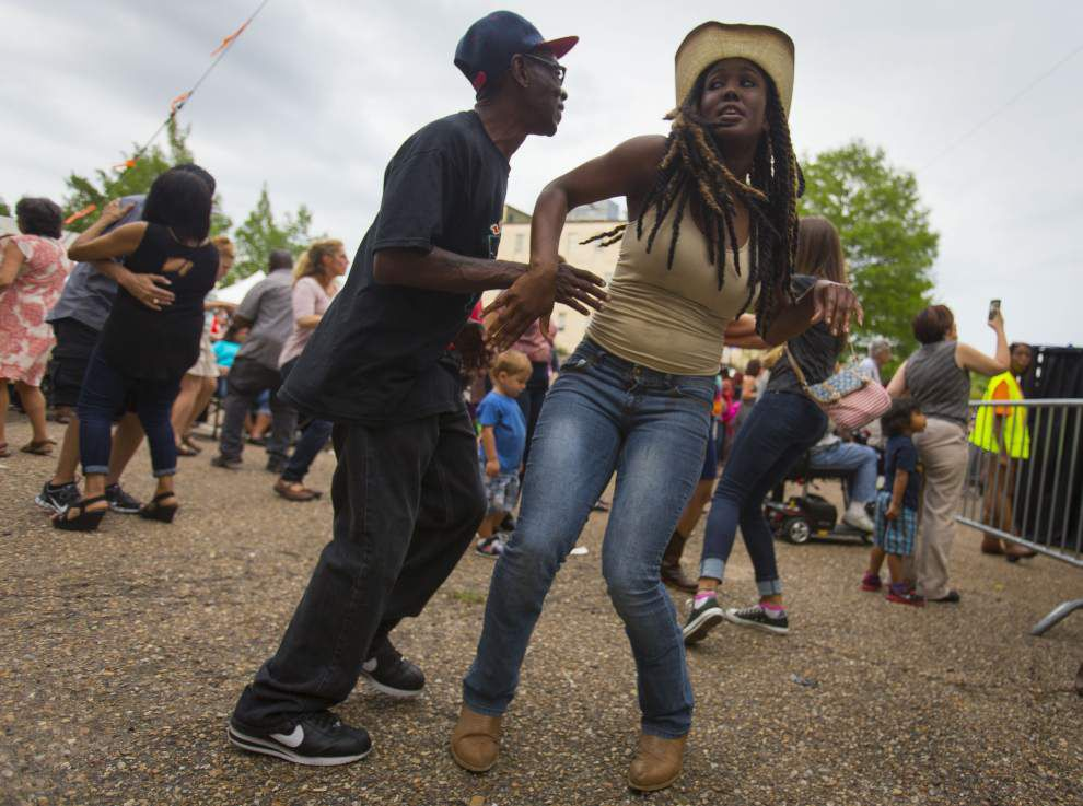 Photos: Festival International de Louisiane unfurls with Dwayne Dopsi & the Zydeco Hellraisers laying down the music, dancing and partying _lowres