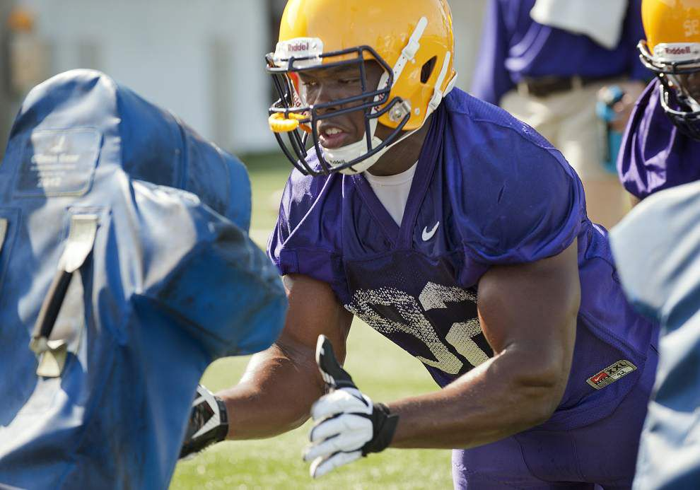 Change brewing? LSU opens camp with new faces challenging, different QB taking 1st snaps _lowres