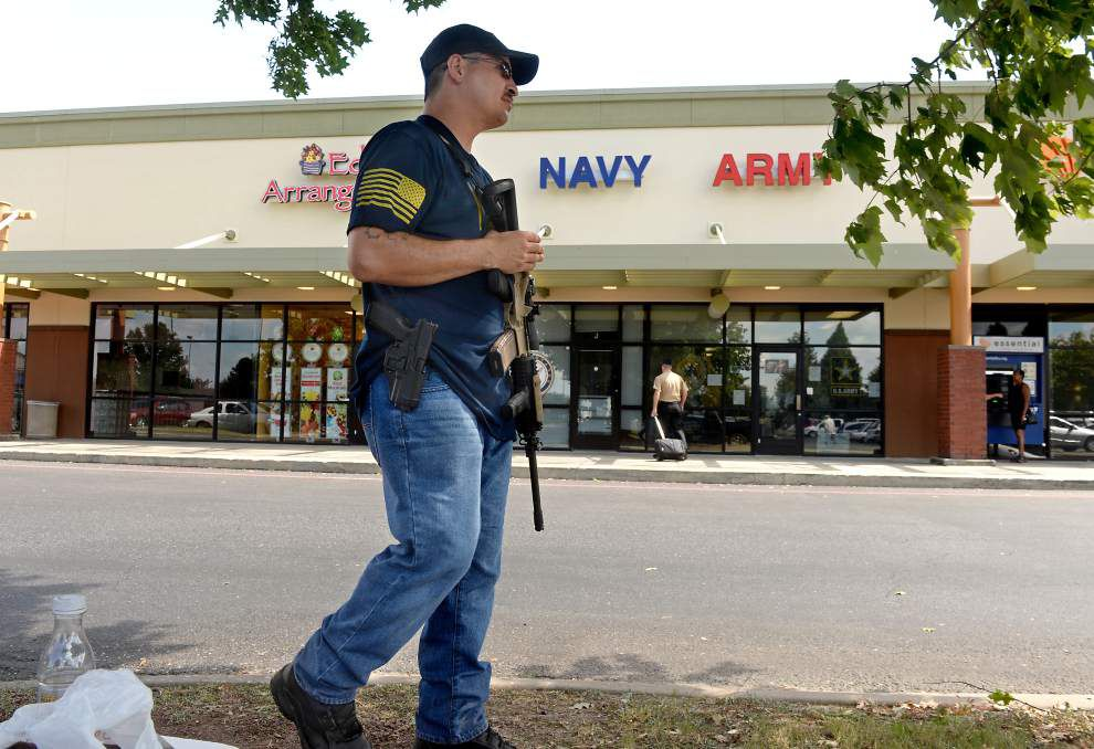 Armed with rifle, Navy vet now guards Baton Rouge military recruitment office _lowres
