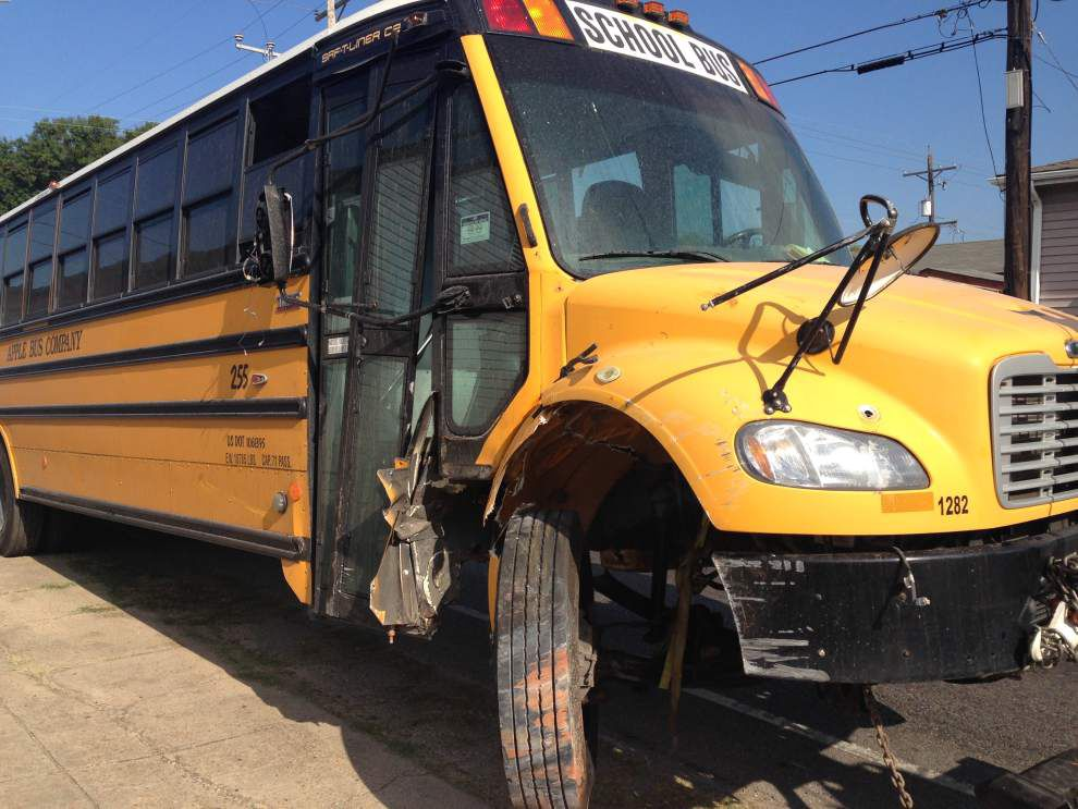 SUV crashes into New Orleans school bus after police pursuit Wednesday morning; no children on board _lowres