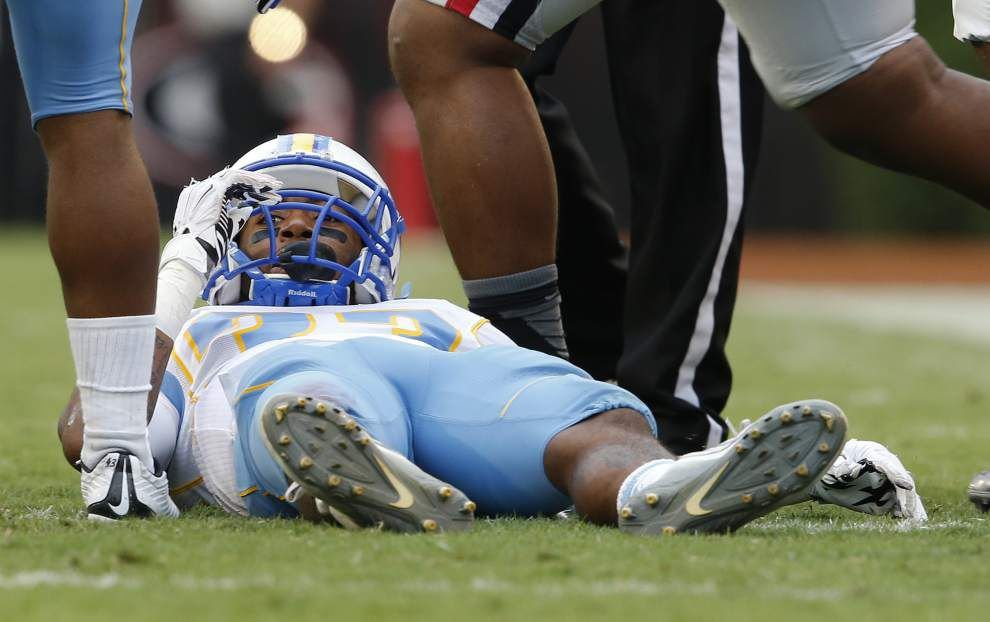 Latest on Southern football player Devon Gales: Georgia players wear light blue sticker with his jersey number on helmets, family honored at game against Alabama _lowres