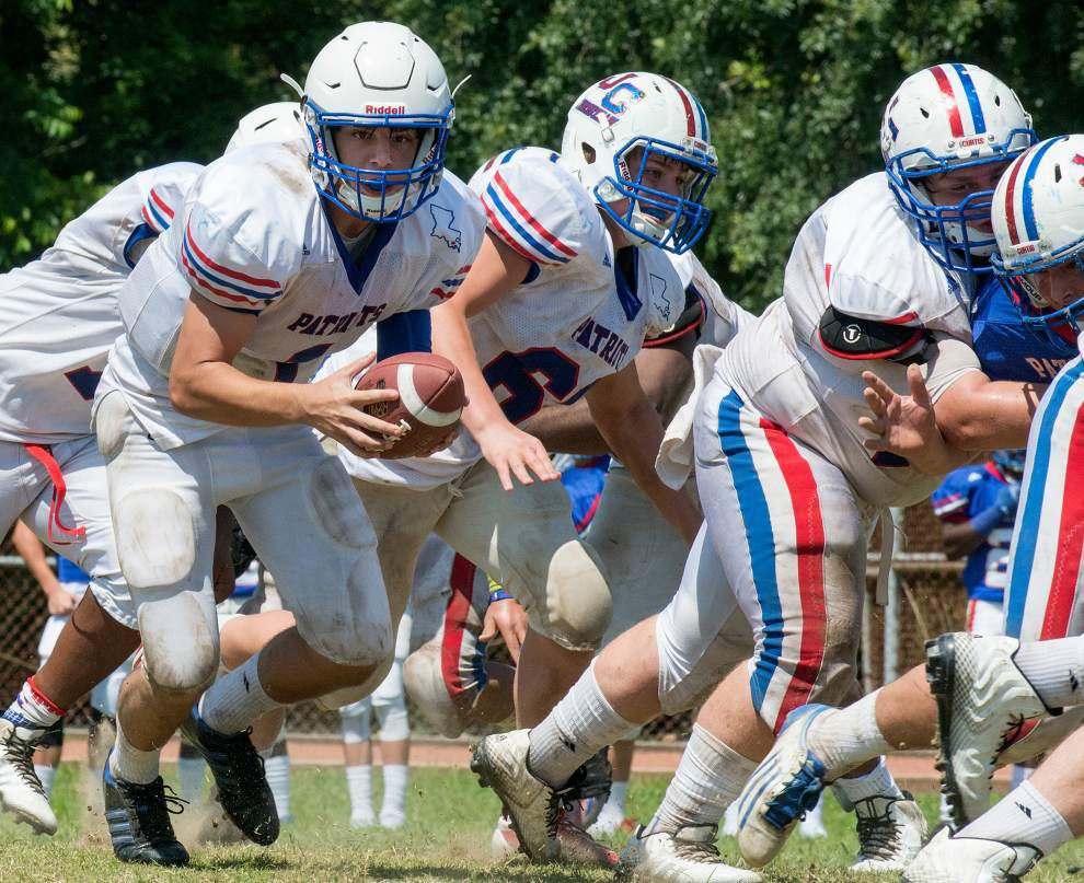 New faces emerge as John Curtis begins transition year in football _lowres