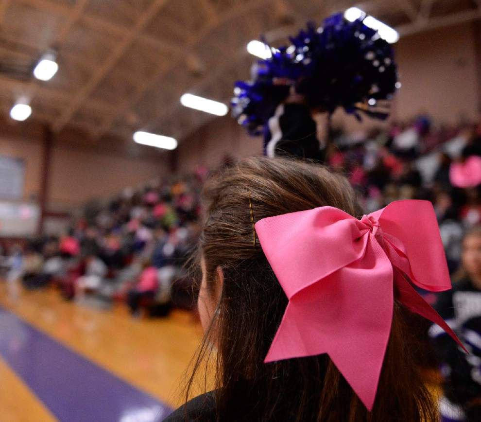Griffins, Gators wear pink in memory of team manager _lowres