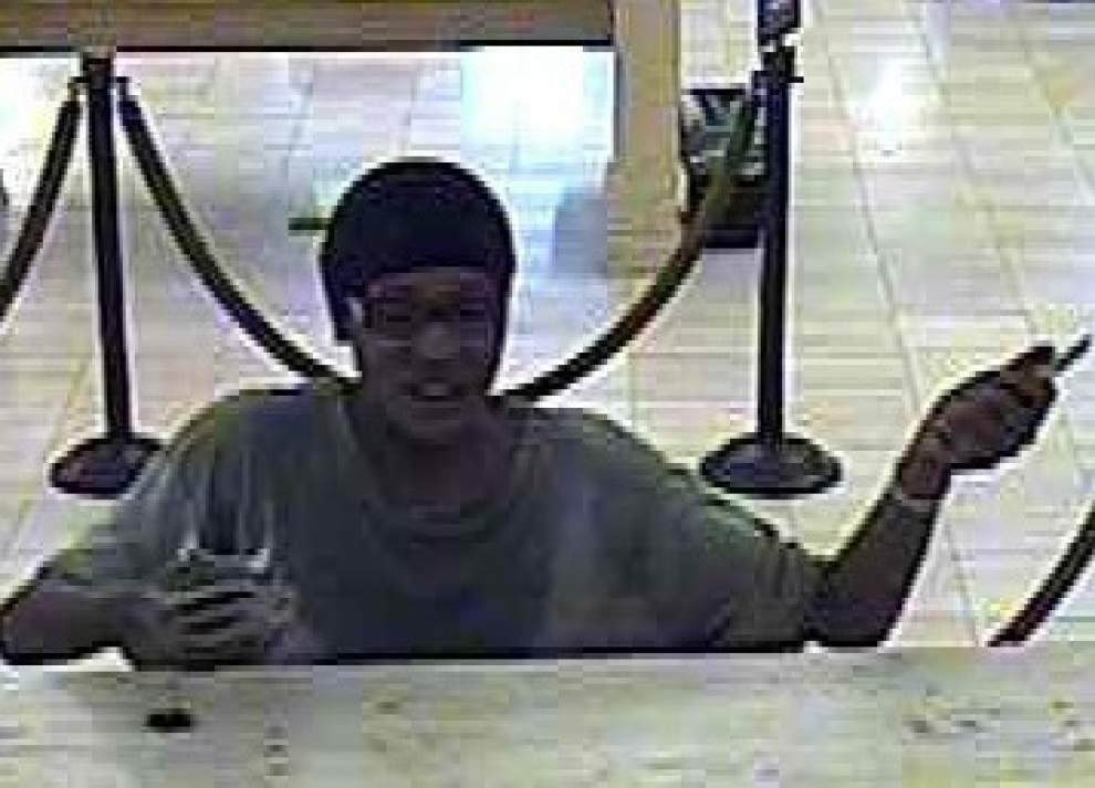 Woman armed with knife robs CBD bank _lowres
