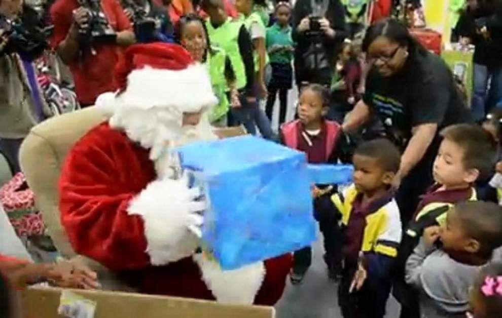 BRPD, Santa deliver toys to Audubon Elementary students _lowres