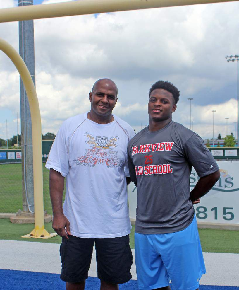 Kayin White had a breakthrough year with Parkview Baptist as a running back last season. His dad, former LSU great Lyman White, is soaking it up, glad to be in the background _lowres