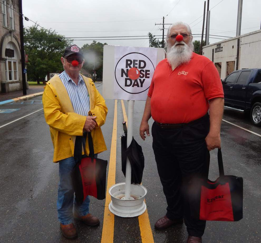 Lions don red noses to fight area poverty _lowres