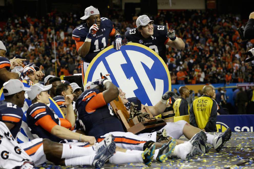 SEC schools to share record $309.6 million for 2013-14 _lowres