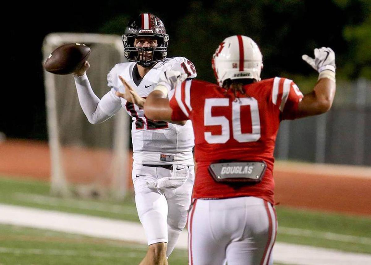 S. Stanislaus quarterback Myles Brennan throws the ball while b