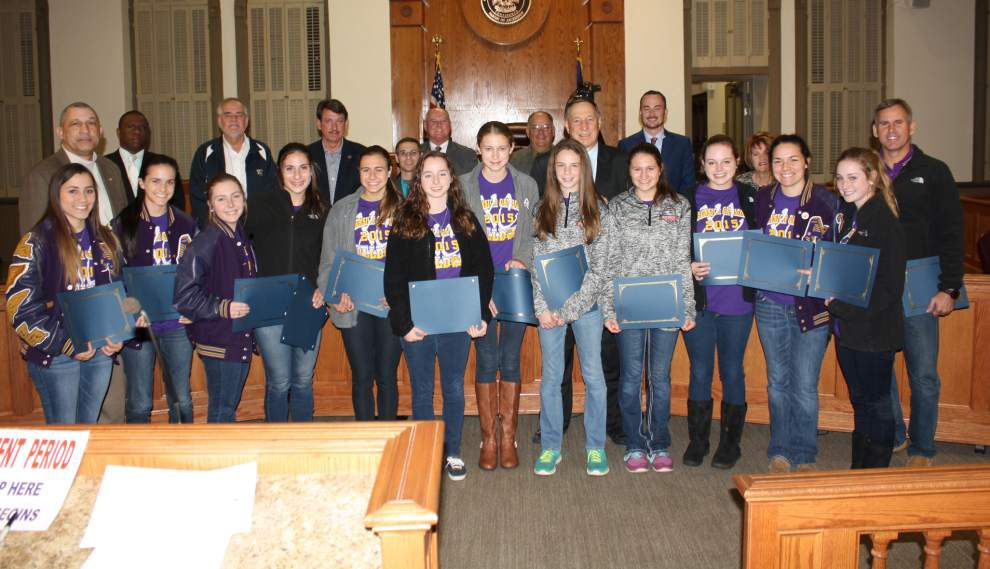 Ascension Catholic's cross country team honored by parish president _lowres