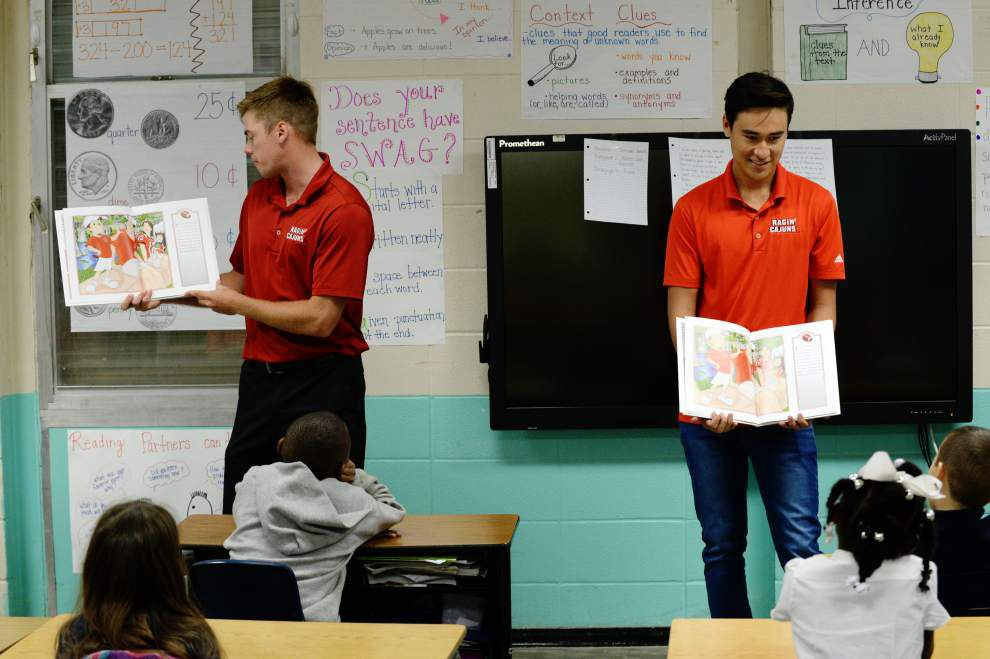 Ragin Cajun athletes read to S.J. Montgomery Elementary School students Wednesday during 'Reading In Red' tour _lowres