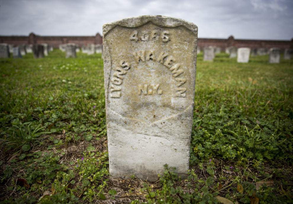 Volunteers bring back names of dead in Chalmette cemetery restoration project _lowres