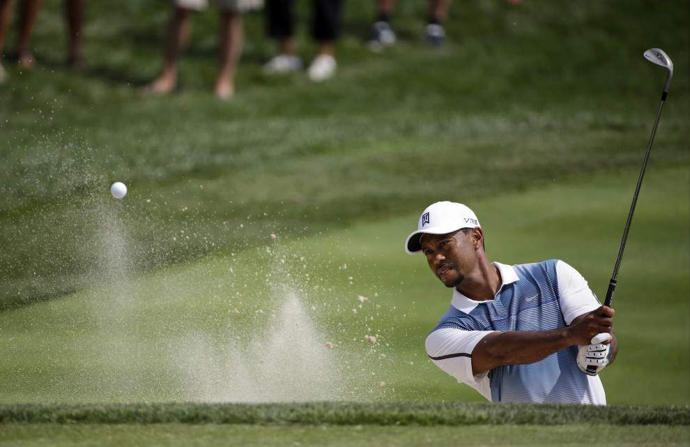 Woods not backing out PGA _lowres
